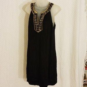 Black sleeveless dress with gold trim